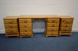 A PINE DESK with eight drawers. width 132cm, a pair of three drawer bedside cabinets, raised on
