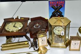 SIX 20TH CENTURY CLOCKS, comprising a Black Forest cuckoo clock with two pine cone weights, height