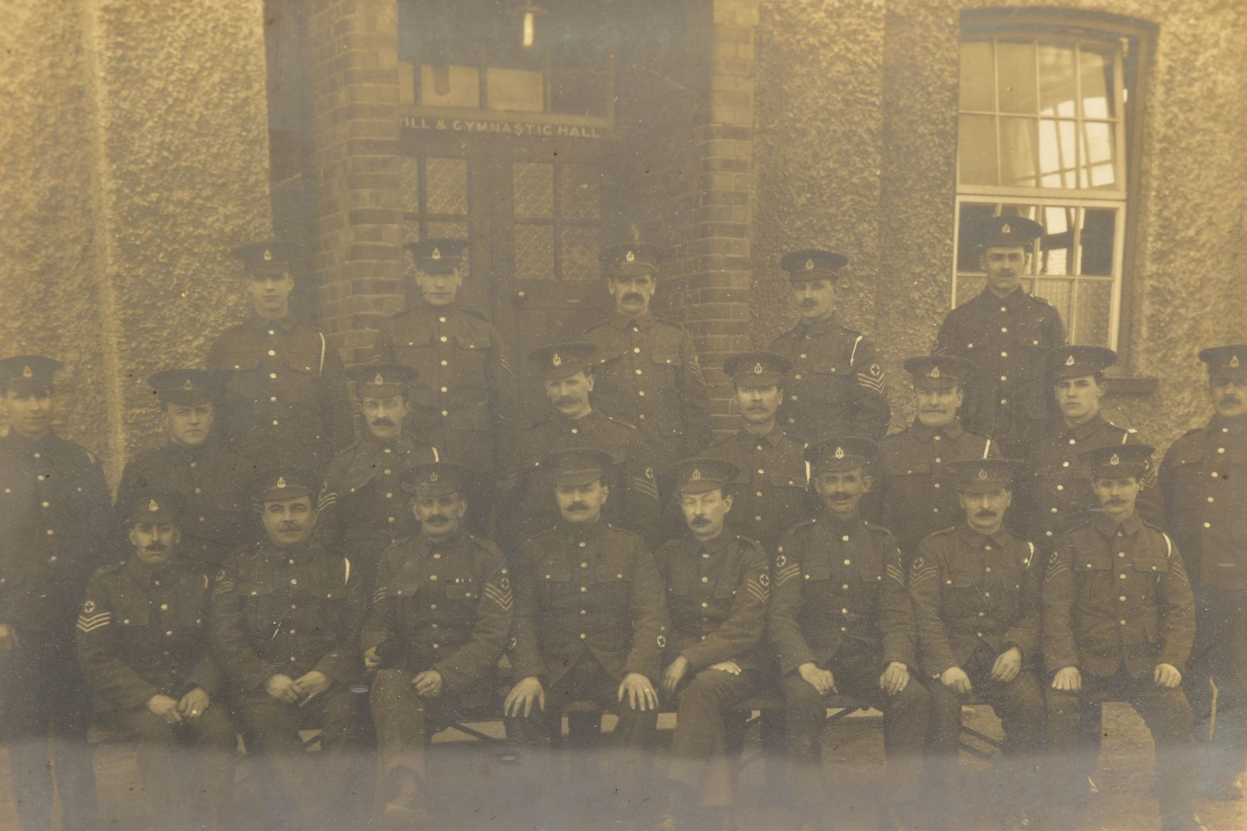 A LARGE GLAZED FRAME WITH A WWI PERIOD PHOTO OF A COMPANY OF SOLDIERS, in uniform, believed RAMC, - Image 2 of 8