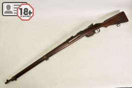 A STEYR MANNLICHER MODEL 95 MILITARY RIFLE CONVERTED TO .410'', the magazine had a plate welded