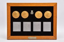 A WOODEN FRAME APPROXIMATELY 36CM X 27CM CONTAINING WHAT IS BELIEVED TO BE A SOLID SILVER BADGE