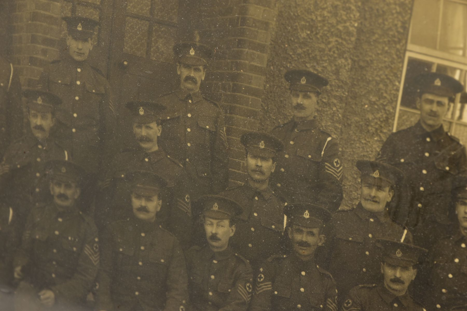 A LARGE GLAZED FRAME WITH A WWI PERIOD PHOTO OF A COMPANY OF SOLDIERS, in uniform, believed RAMC, - Image 3 of 8