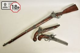 THREE WHITE METAL COPIES OF ANTIQUE FIREARMS, the first is a copy of a Miquelet flintlock pistol