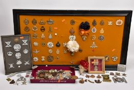 A LARGE FRAME OF OVER THIRTY FIVE MISCELLANEOUS MILITARY CAP BADGES including North Staffs, RAC,