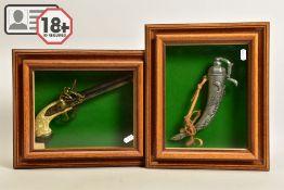 A NEATLY FRAMED DISPLAY CASE containing a cast metal replica of a three barrel flintlock pistol