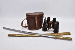 A BROWN LEATHER CASE BOXED PAIR OF BELIEVED IMPERIAL JAPANESE ARMY WWII ERA BINOCULARS, the left