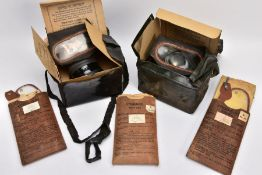A BOX CONTAINING TWO WWII ERA HOME FRONT GAS MASKS in boxes and three sets of anti gas eye