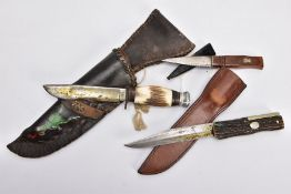 A BOX CONTAINING TWO CAMPING STYLE KNIVES AND SCABBARDS fake bone handles, etc and a Scottish 'Sgian