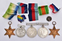 A GROUP OF FOUR WWII MEDALS (1939-45, Atlantic Stars Defence & War Medal), together with a 25th