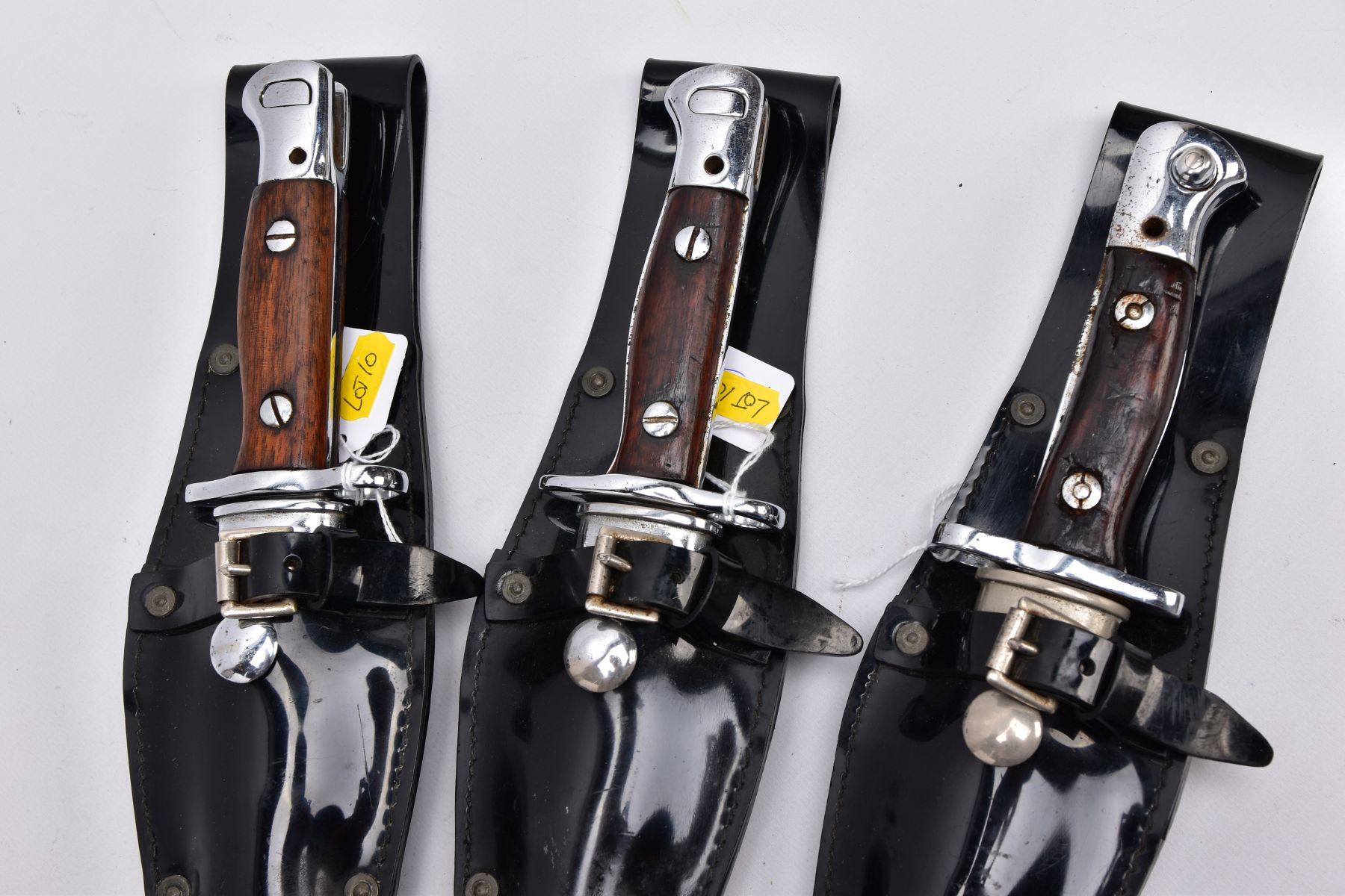 THREE X 1907 PATTERN SMLE DRESS BAYONETS, in high gloss belt frogs and scabbards, the grips being - Image 2 of 12
