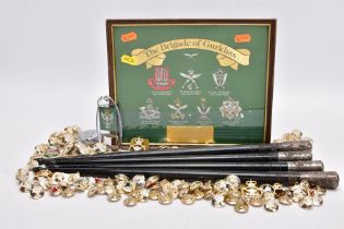 A SMALL GLAZED FRAME WITH EMBOSSED COLOURED EMBLEMS FOR THE BRIGADE OF GURKHAS, with a small plate