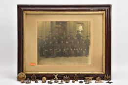 A LARGE GLAZED FRAME WITH A WWI PERIOD PHOTO OF A COMPANY OF SOLDIERS, in uniform, believed RAMC,