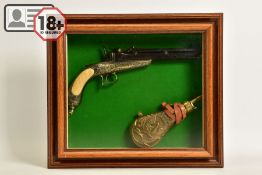 A NEATLY FRAMED DISPLAY CASE containing a cast metal replica of a Collette Gravity pistol,