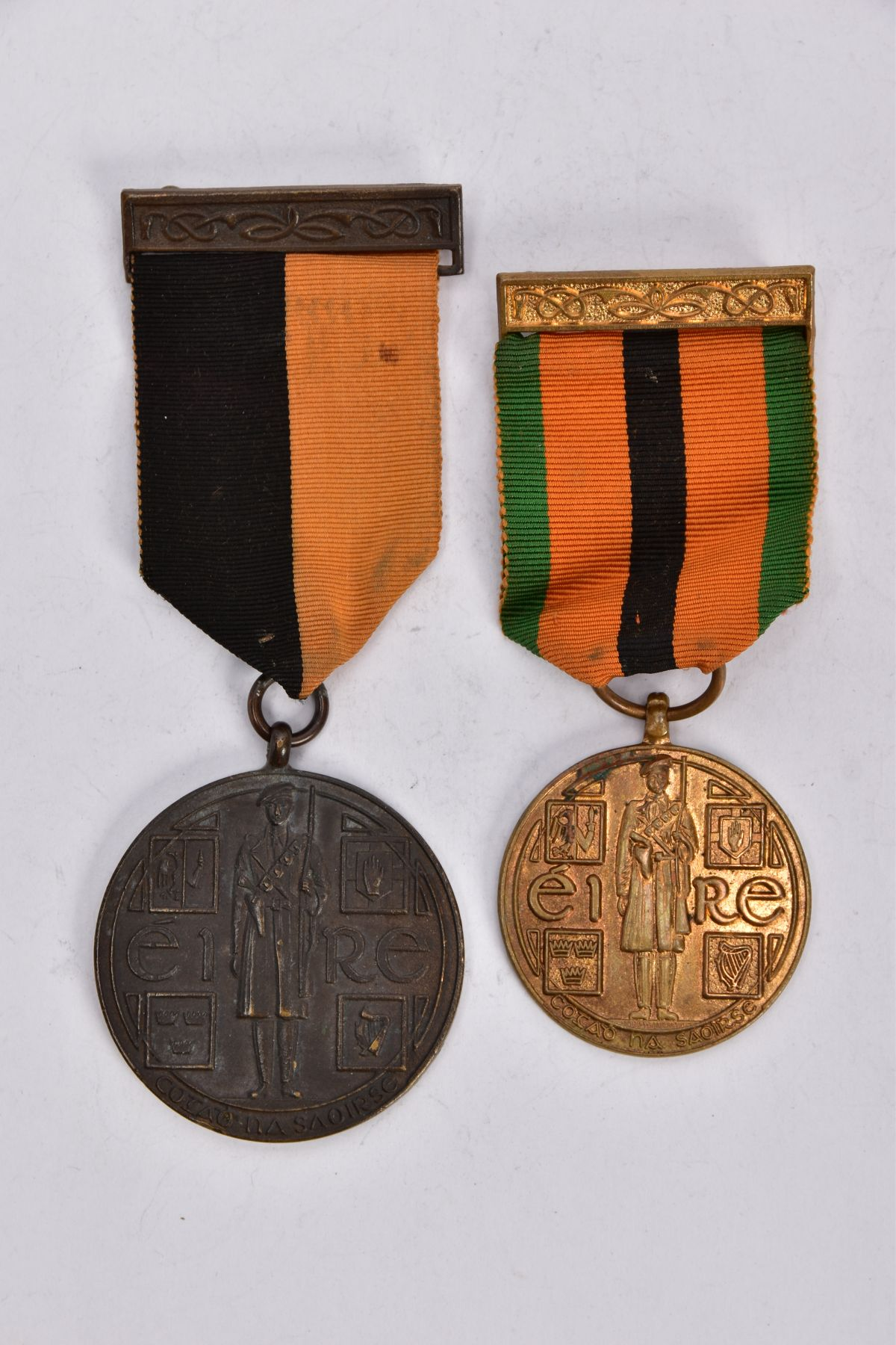 'IRISH WAR OF INDEPENDANCE MEDALS' both with wearing bar clasps, but believed to be later produced