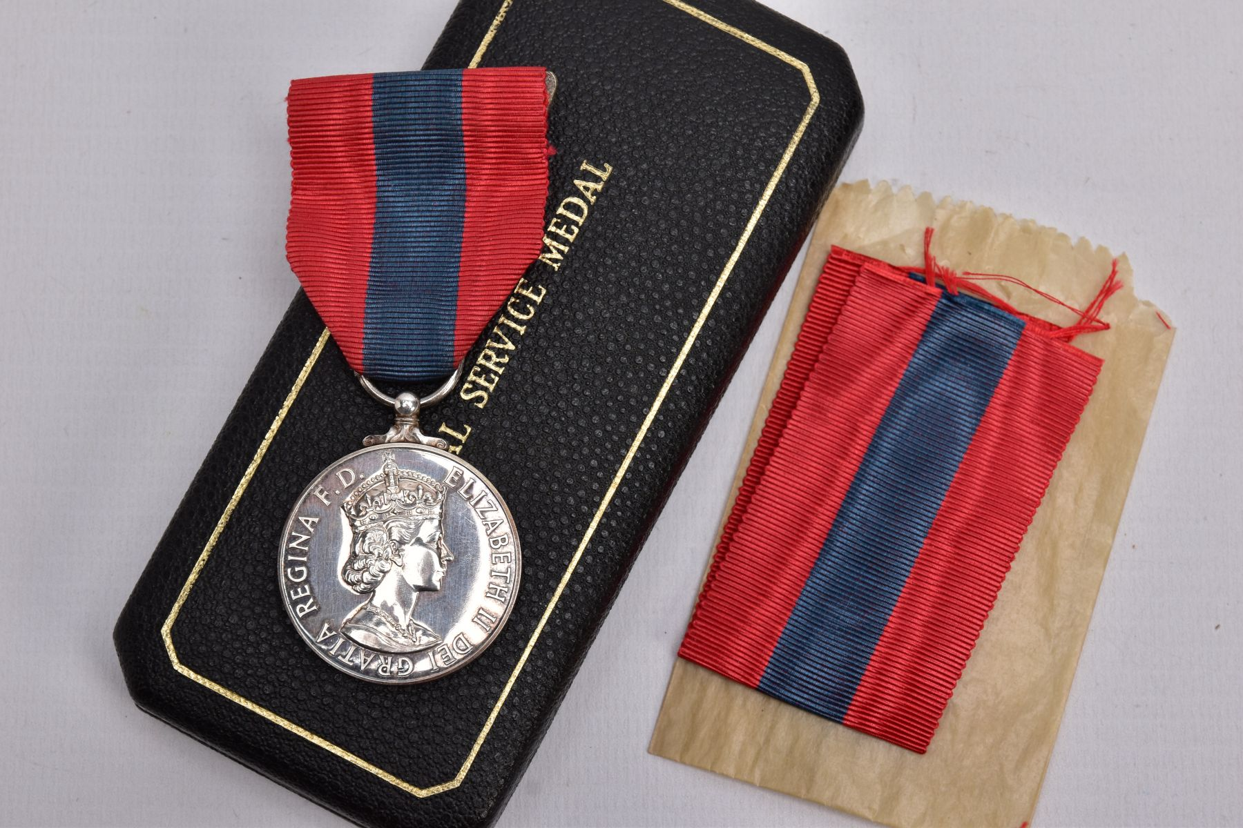 A BOXED ROYAL MINT IMPERIAL SERVICE MEDAL named to Hubert Martin, ERII Dei-Gratia 1955 version