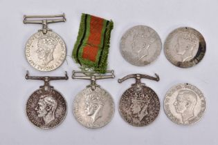 A BAG OF SEVEN WWII DEFENCE AND WAR MEDALS un-named as issued, poor condition, some missing ribbon