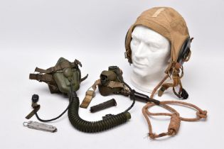 A WWII ERA USA FLYING HELMET IN BEIGE CANVAS WITH ATTACHED RADIO COMMUNICATION LEAD, the cap is by
