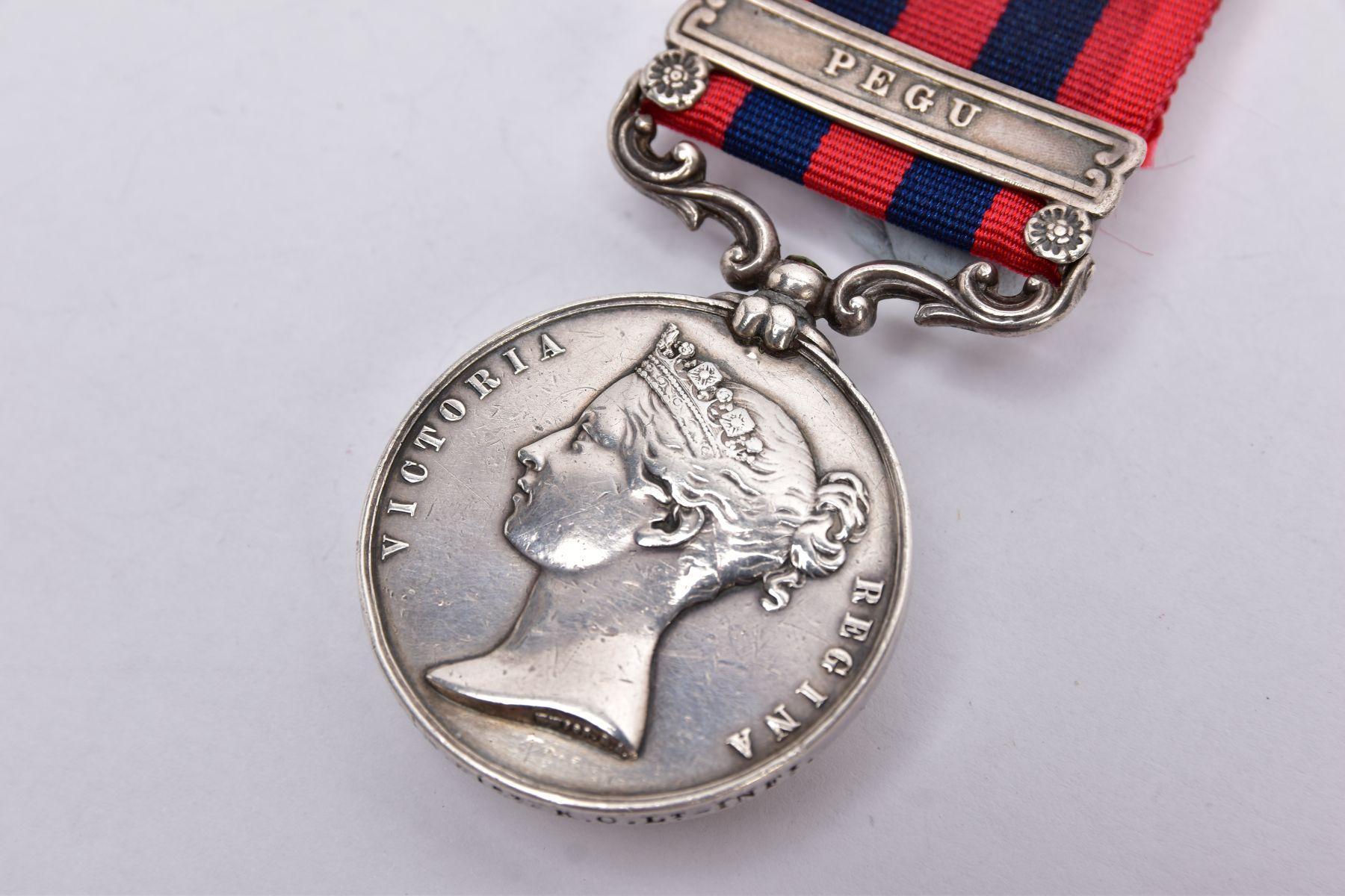 INDIA GENERAL SERVICE MEDAL 1854, Bar Pegu, named on rim John Haniin 51st K.C.Lt Infantry - Image 2 of 8