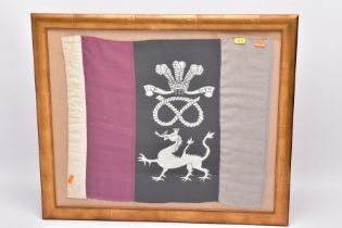A GLAZED FRAME CONTAINING A REGIMENTAL PENNANT, approximately 50cm x 42cm, the pennant has three
