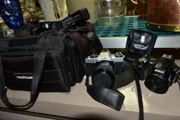 PHOTOGRAPHIC EQUIPMENT, comprising Minolta XG-1 35mm film SLR Camera body fitted with a Sirius 28-70
