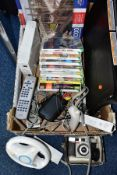 A NINTENDO WII CONSOLE, not tested, balance board, transformer, controllers, quantity of games