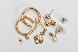 A SELECTION OF YELLOW METAL JEWELERY, to include a pair of plain polished hoop earrings,