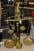 A SET OF PORTUGESE STYLE TWIN BEAM BALANCE SCALES, brass construction with bulls head capitol, two
