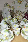 A BELL CHINA PRIMROSE PATTERN PART TEA SERVICE, comprising eleven tea cups, saucers, twelve tea