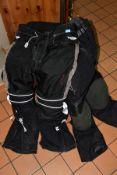 A PAIR OF TRIUMPH AIRFLOW TECH MOTORBIKE TROUSERS, a pair of AKITO motorbike trousers, a Simply