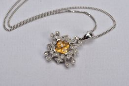 A WHITE METAL CITRINE AND DIAMOND PENDANT NECKLACE, the pendant centring on four square cut