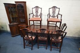 A STAG MAHOGANY DINING SUITE, comprising an extending twin pedestal table, extended length 214cm x