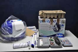 A BRAND NEW IN BOX DULUX PAINT POD ROLLER SYSTEM with power supply, roller, two extension pieces etc
