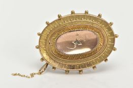 A LATE VICTORIAN BROOCH, of an oval form set with a single rose cut diamond, within a floral