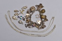 A SILVER CHARM BRACELET, LOOSE CHARMS AND TWO WHITE METAL CHAINS, the charm bracelet fitted with a
