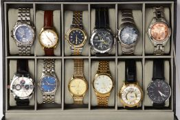 A WATCH DISPLAY CASE WITH WATCHES, faux leather black case with a glass window, twelve watch storage
