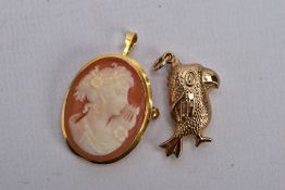 A 9CT GOLD PENDANT AND A YELLOW METAL CAMEO BROOCH/PENDANT, the first a hollow pendant in the form
