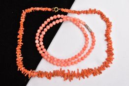 TWO CORAL NECKLACES, the first a polished pink coral bead necklace, each bead measuring