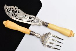 A VICTORIAN SILVER AND IVORY HANDLED FISH KNIFE AND FORK SERVERS, pierced detailed blades, with an