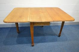 AN ARTS AND CRAFTS OAK GATE LEG TABLE, on square tapered legs, width 50cm x open width 106cm x depth