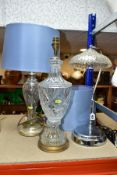 THREE ELECTRIC LAMPS, comprising a cut glass urn shaped table lamp with blue shade, height