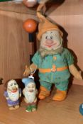 A CHAD VALLEY DISNEY SEVEN DWARFS DOC FIGURE, pressed felt with painted features, green linen suit