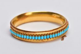 A LATE VICTORIAN TURQUOISE HINGED BANGLE, of slight concave design, the back half with central