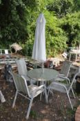A METAL FRAMED GARDEN TABLE with glass top 91cm in diameter with four matching chairs and a