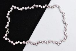 A SILVER CUBIC ZIRCONIA NECKLET, the full chain set with alternating sizes of circular cut, pink