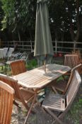 A MODERN HARDWOOD FOLDING GARDEN TABLE 150cm long 80cm deep, six folding chairs including two