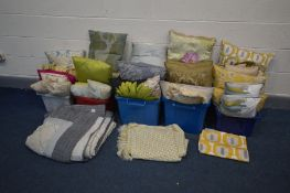 A COLLECTION OF CUSHIONS in various styles, sizes and colours together with two throws and a table