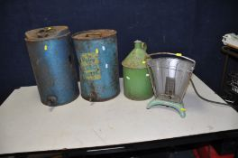 TWO VINTAGE PARAFFIN DRUMS one with complete tap , the other not, a vintage paraffin can with