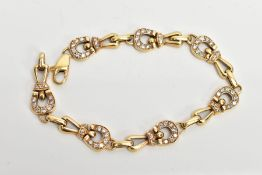 A DIAMOND SET BRACELET, designed as horse shoe shaped links set with round brilliant cut diamonds,