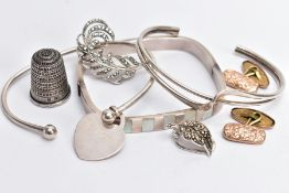 A SELECTION OF ITEMS, to include two silver cuffs each with full hallmarks for Birmingham and