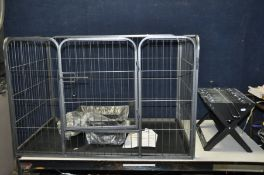 A WIRE FRAME DOG PEN with plastic base open top and single door width 108cm depth 73cm and 70cm